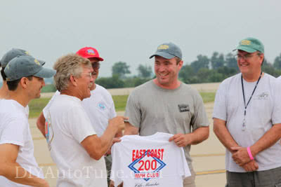 Jerry being received into the ECTA 200mph Club with club t-shirt and the 'grey hat'.